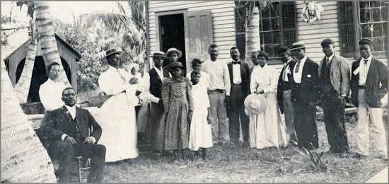 Black community gathered in front of the Ralph Munroe boathouse, Coconut Grove, Florida, circa 1890s.