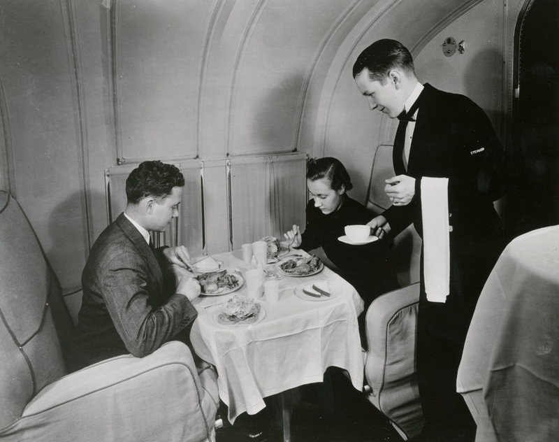 Pan American World Airways Steward serving dinner aboard a Martin M-130