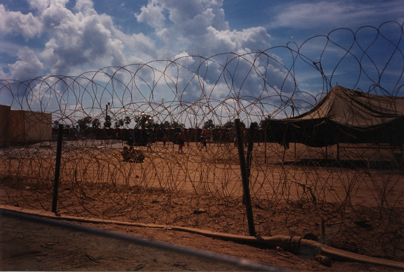 Cuban rafters' camp surrounded by concertina wire, 1990s