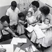 Women with children at the Cuban Refugee Center