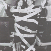 Pan Am flight attendants promoting a sales game in honor of the airline's 50th anniversary