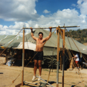 Staying fit at the Guantanamo Bay refugee camps with a makeshift gym and weights, 1990s