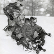 Four Cuban boys sled in the snow in Columbus, Ohio