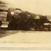 Mailbags arranged in front of a Pan American Airways Sikorsky S-38