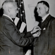 Juan Trippe receiving Medal of Merit from Secretary of War, Robert P. Patterson