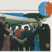 Employees from Pan Am shaking hands with National Airlines employees to commemorate the merger of the two companies in 1980