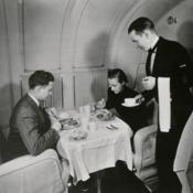 Pan American World Airways Steward serving dinner aboard a Martin M-130