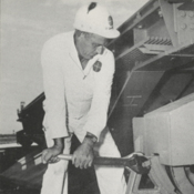 A Pan Am GMRD employee performing maintenance on Pad 14 at Cape Canaveral
