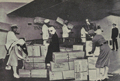 Red Cross nurses and workers loading supplies for the European war zone in 1944