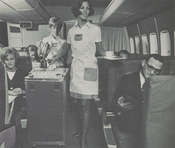 Pan Am stewardesses donned French butler's aprons to serve cuisine by Maxim's on Paris flights